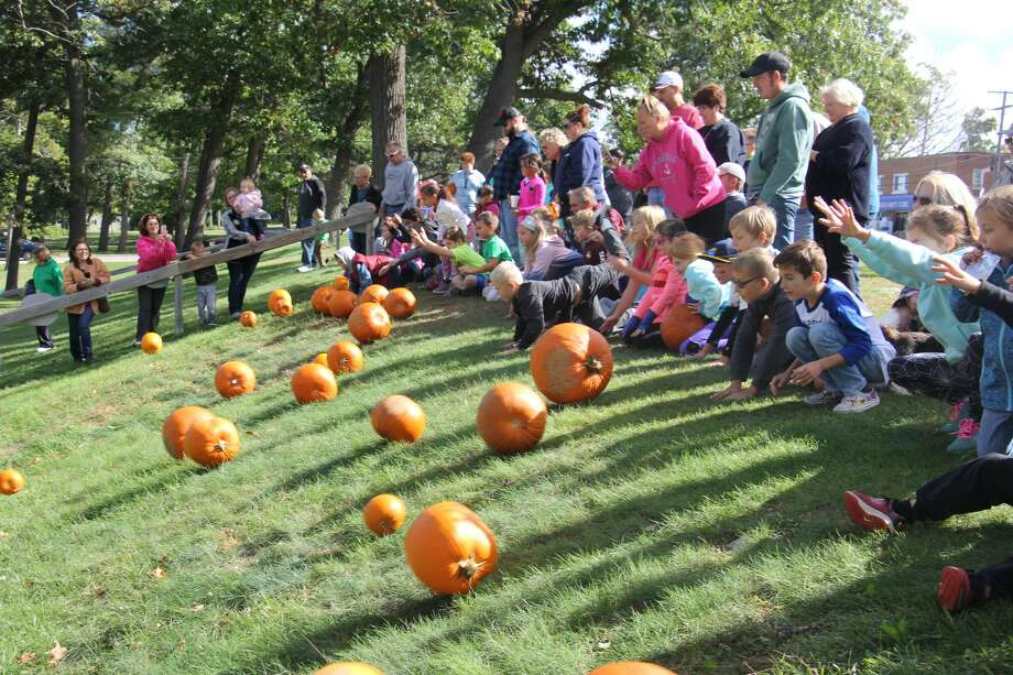 The 17th annual Caseville Pumpkin Fest is set to kick off Saturday morning with a number of activities, including the pumpkin roll. Here's a look back at scenes from last year's celebration Photo: Tribune File Photo