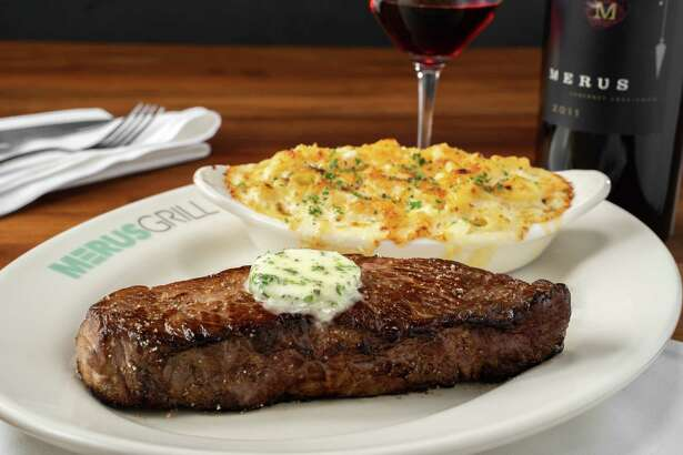 Prime New York strip steak served with macaroni and cheese at Merus Grill, a new restaurant from J. Alexander's Holdings opening in November in Uptown Park.