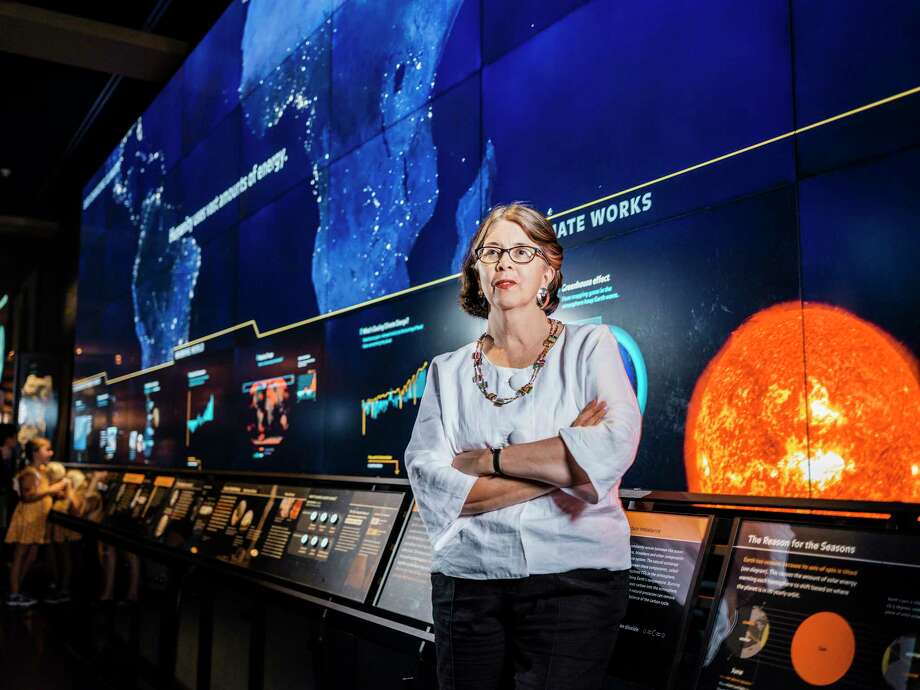 Lauri Halderman, vice president for exhibition, in front of the permanent installation of the interactive climate change exhibit at the American Museum of Natural History in New York. Photo: Photo For The Washington Post By Chris Sorensen / For The Washington Post