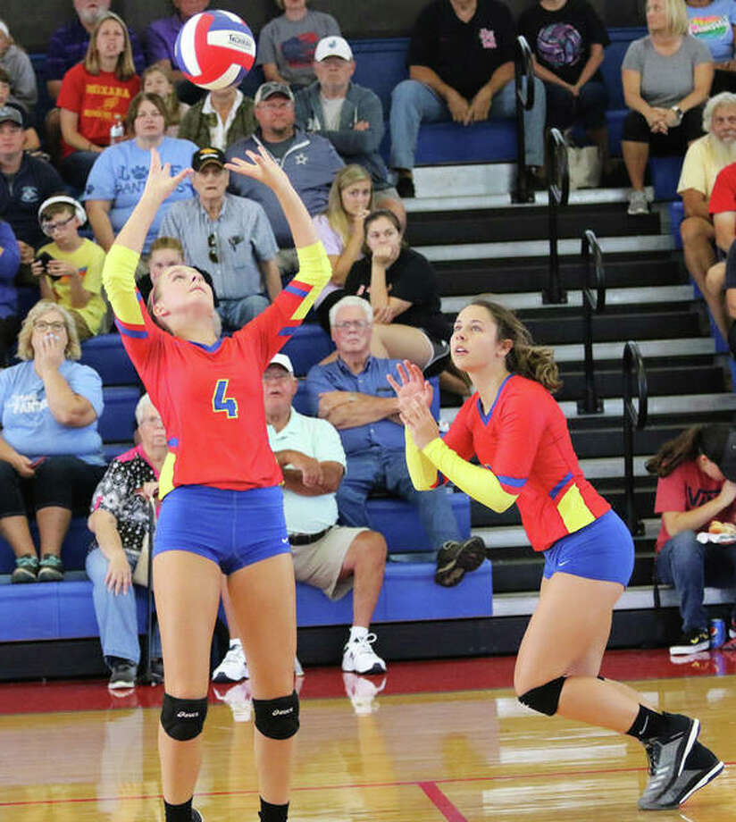 Roxana's Kiley Winfree (right) heads to the net while Macie Lucas back sets during a match at the Roxana Tourney on Aug. 31. The Shells were in Bethalto on Tuesday night and posted a two-set victory over Civic Memorial. Photo: Greg Shashack / The Telegraph
