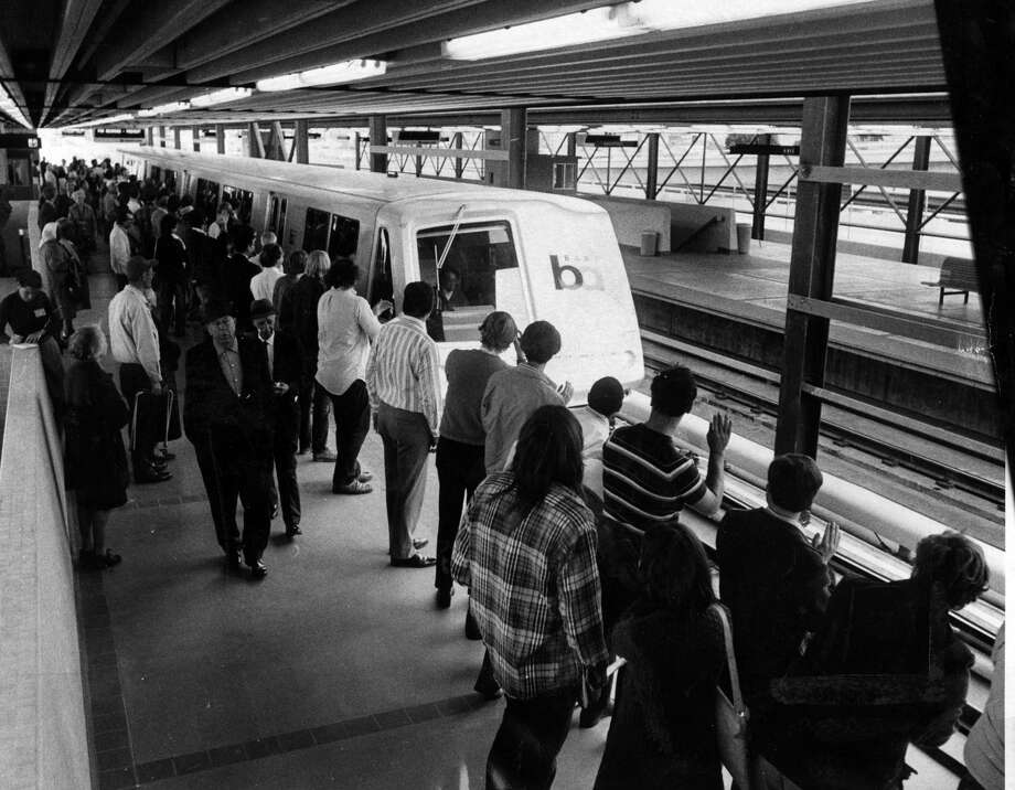 Passengers clap as the first train pulls into MacArthur station on the first day of service for BART. Photo: Peter Breinig/The Chronicle