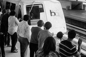 Passengers clap as the first train pulls into MacArthur station on the first day of service for BART Photo ran 09/12/1972, p. 4