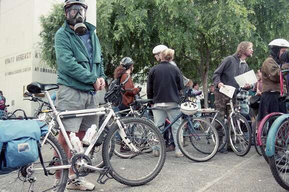 May 27, 1994: A Critical Mass participant wears a gas mask during  one of the earliest bicycle rides on the city's streets.