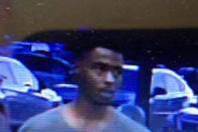 Crime Stoppers is offering a reward for a man they say stole a case of beer and assaulted a Walmart employee.