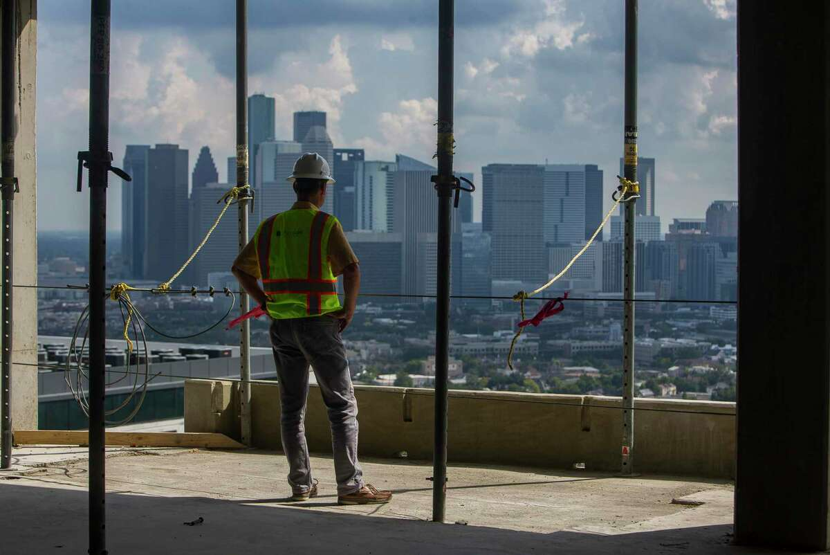 Michael Edelmann, a quality control manager with Hines Urban Oaks, looks at the view of downtown during a visit to the 33rd floor of the La Colombe d'Or Hotel & Residences to mark the topping out of the building in Houston's Montrose neighborhood, Tuesday, Sept. 10, 2019. The Developer Hines is building the 265-unit, high-rise luxury multifamily project next to the historic La Colombe d'Or Hotel.