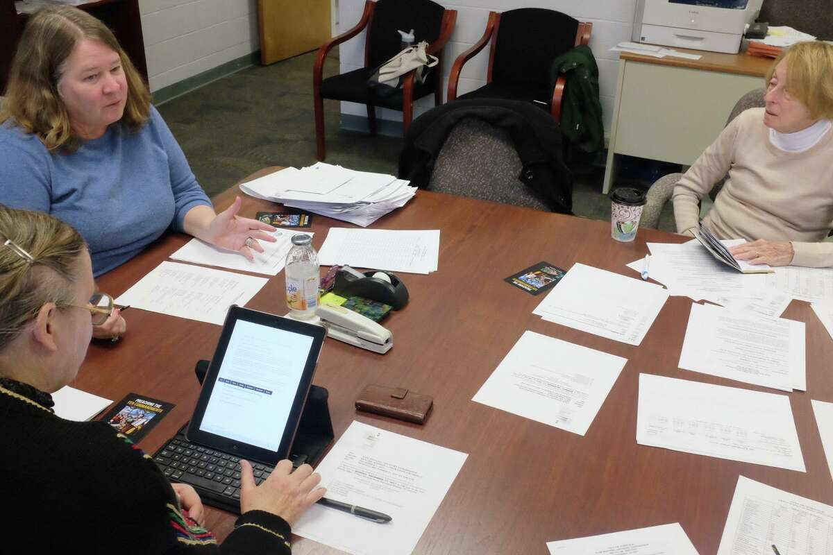 """Fair Housing Officer Margaret K. Suib, top left, and Fair Housing Advisory Commissioner Nancy Burke go over a budget request that includes funding for a study of Norwalk housing discrimination on Dec. 11, 2017. The advisory commission is hosting an """"Ending Sexual Harrassment in Housing"""" on Wednesday."""