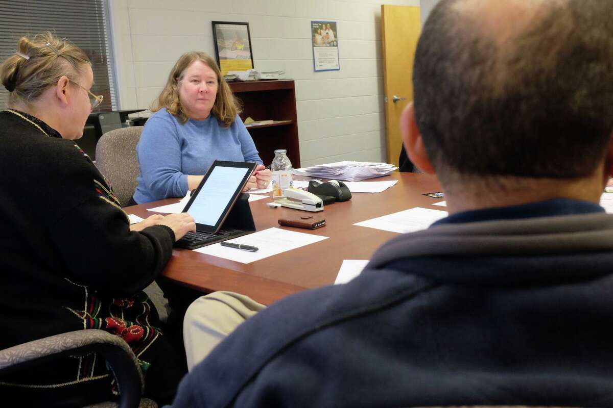 """Fair Housing Officer Margaret K. Suib, center, goes over a budget request that includes funding for a study of Norwalk housing discrimination with the Fair Housing Advisory Commission on Dec. 11, 2017. The advisory commission is hosting an """"Ending Sexual Harrassment in Housing"""" on Wednesday."""