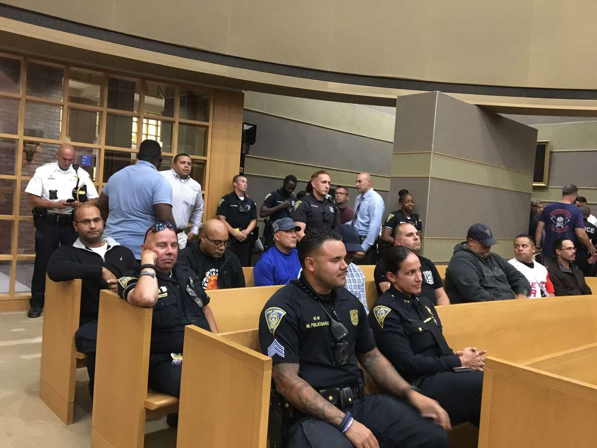 New Haven police filled the Board of Alders chamber awaiting approval of new 6-year police contract.