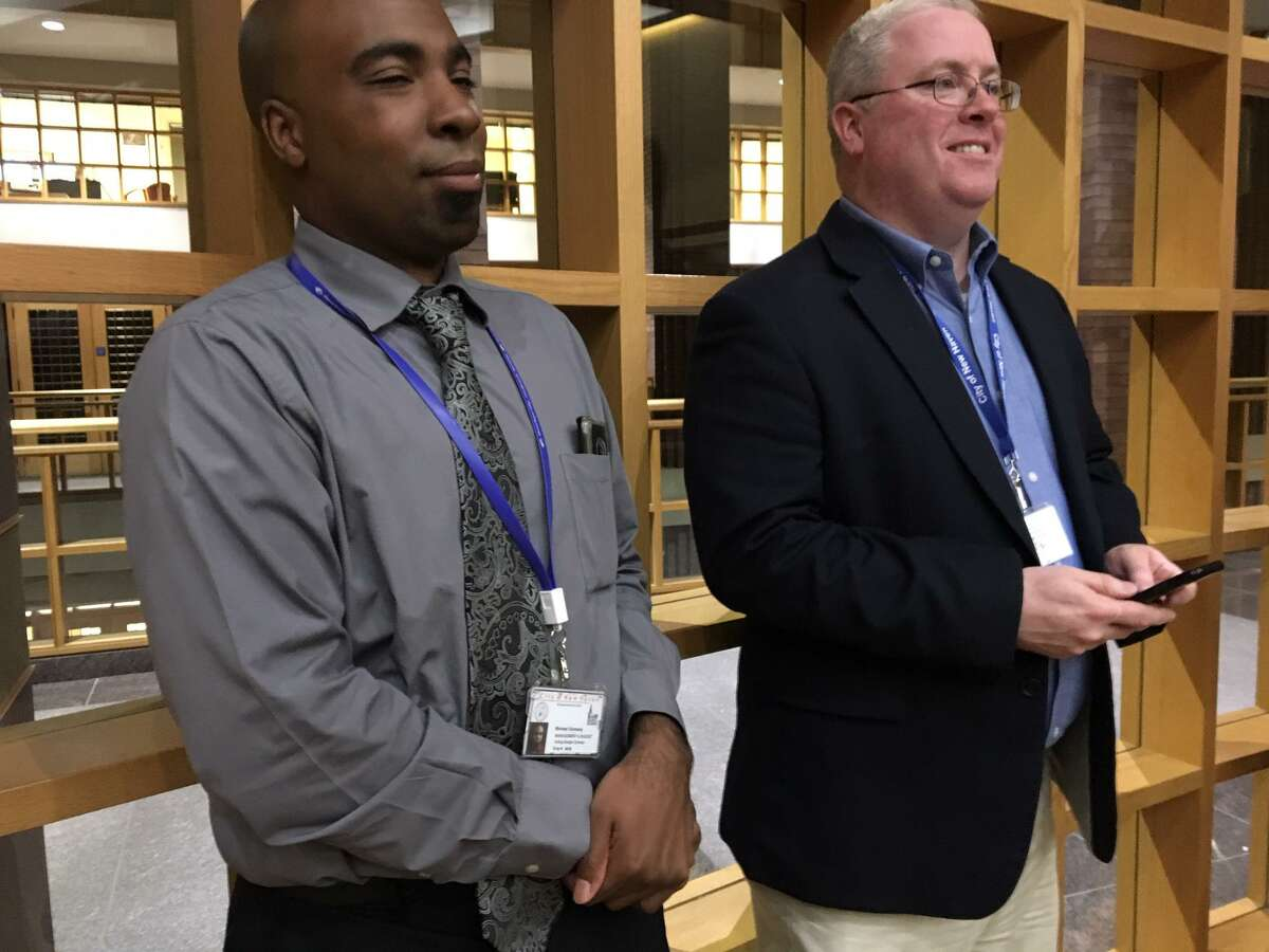 Interim Budget Director Michael Gormany, left, and Thomas McCarthy, New Haven labor relations director at aldermanic vote on police contract.