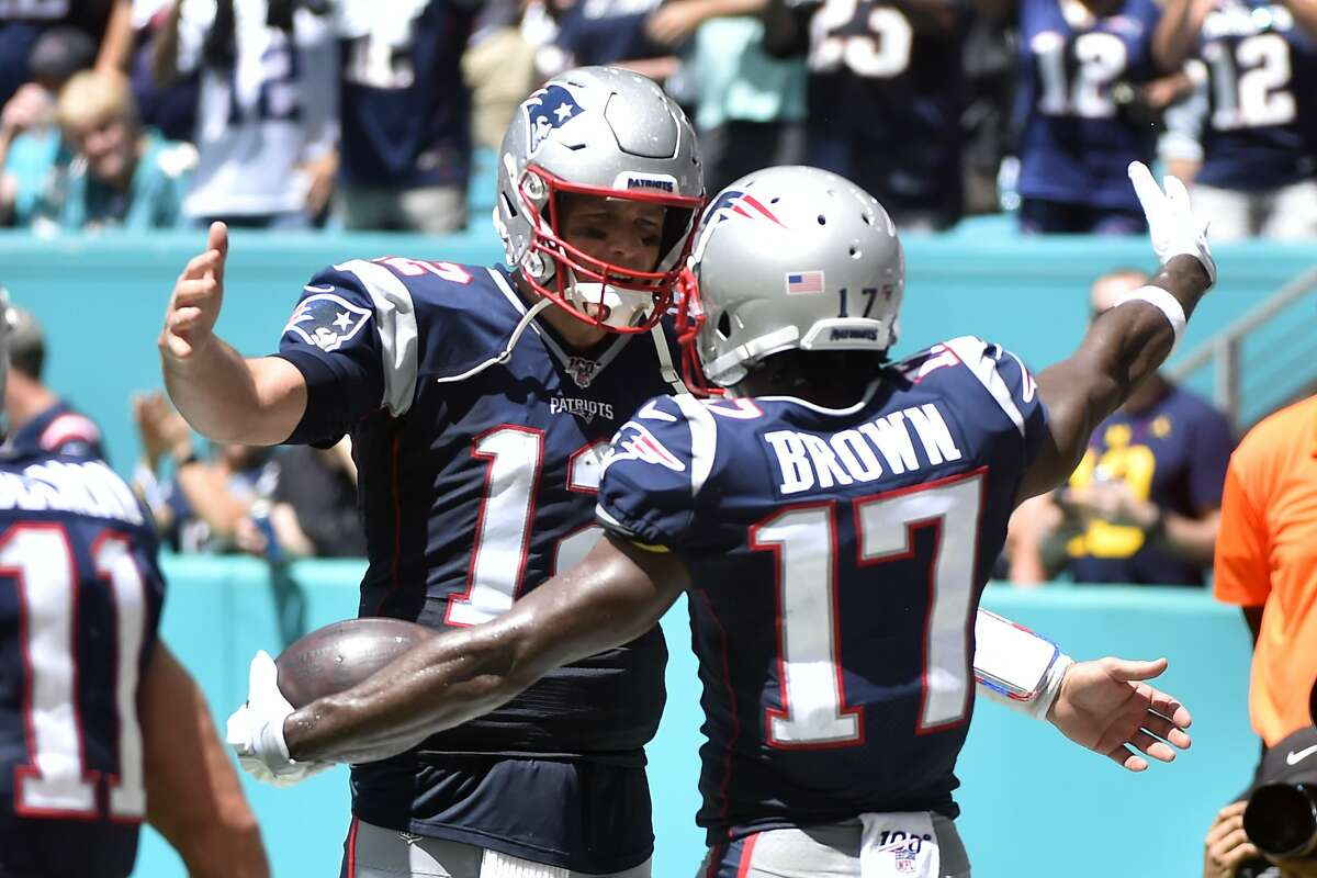 Antonio Brown #17 of the New England Patriots celebrates with Tom Brady #12 after catching a touchdown in the second quarter of the game against the Miami Dolphins at Hard Rock Stadium on September 15, 2019 in Miami, Florida.