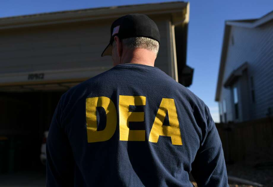 In this file photo, DEA agents take part in an unidentified narcotics raid. Photo: RJ Sangosti/MediaNews Group/The /Denver Post Via Getty Images