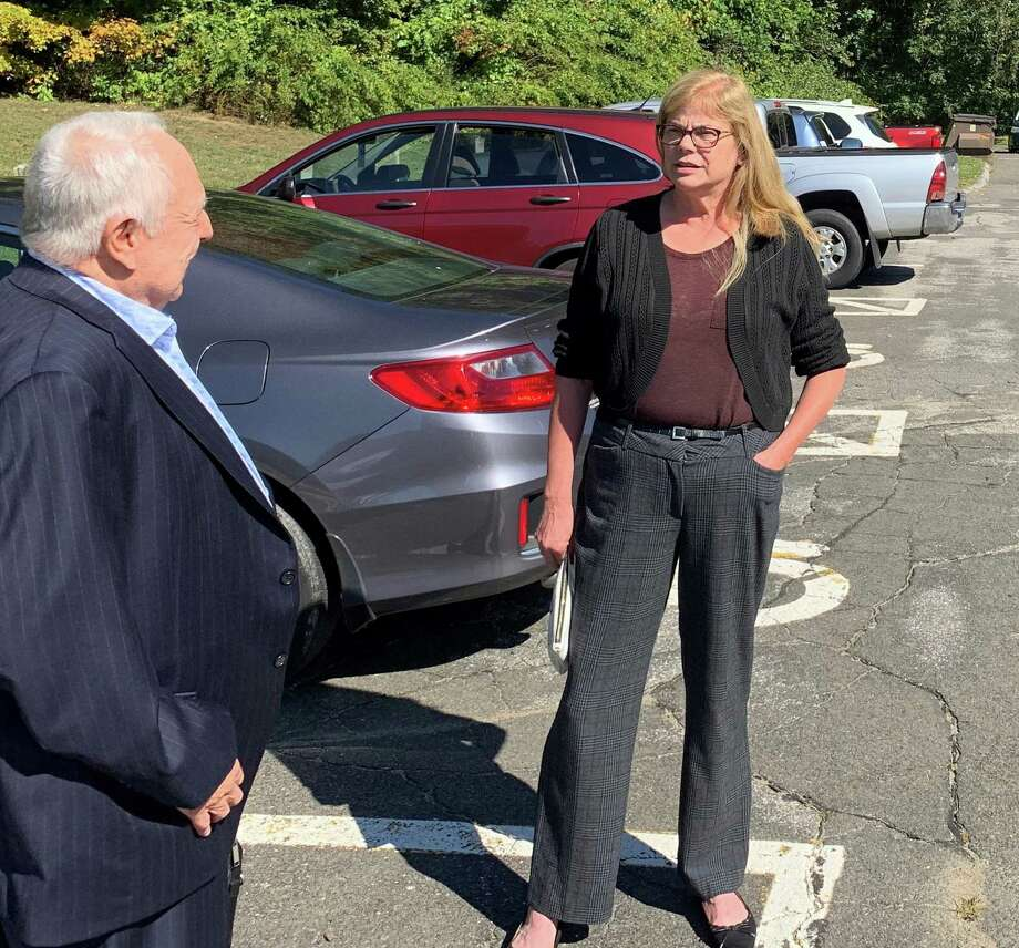 Betsi Hellman discusses her recount victory confirmation with Richard Kosinski, an unaffiliated in the Ixford Tien Hall parking lot Tuesday. Photo: Michael P. Mayko