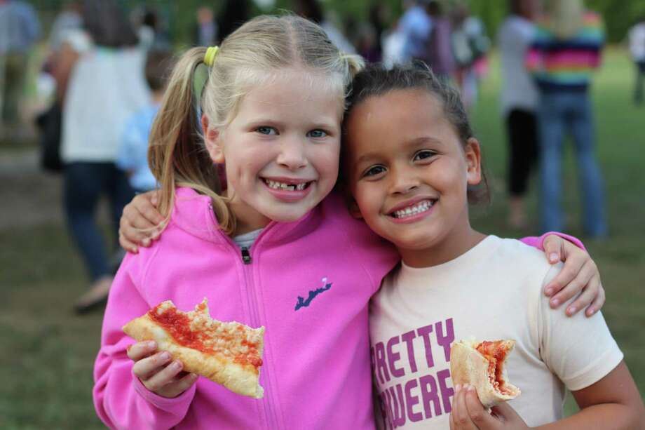 Greta Collins and Tenley Thomas enjoy pizza dinner with family and friends at the Hindley Bash Photo: Hindley School