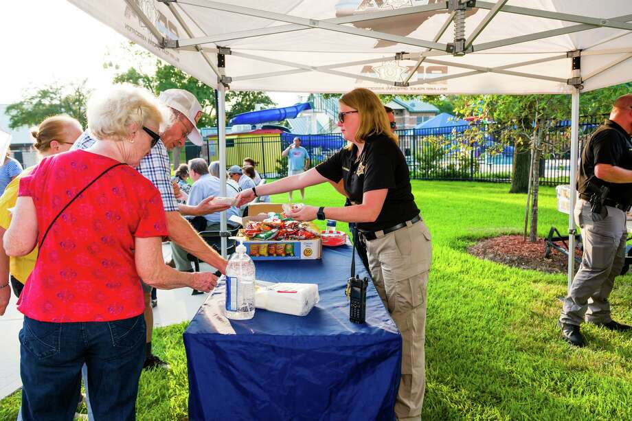 The Bellaire Police Officers Association serves hot dogs to residents as they celebrate the completion of the Municipal Facilities project at the town square on Friday, Sept. 13. Photo: Photo By Dee Zunker Photography, Owner / Dee Zunker