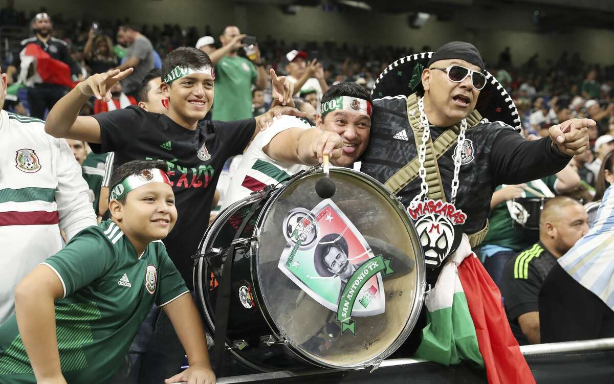 Fans react to the teams coming out on the field to warm up for the Mexico against Argentina International Friendly soccer match at the Alamodome on Tuesday, Sept. 10, 2019.