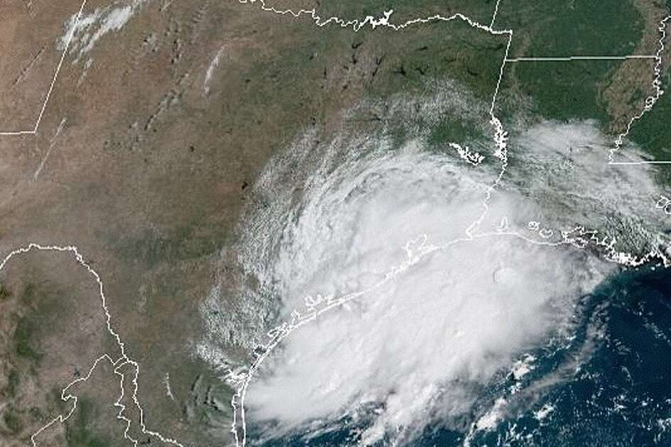 Satellite imagery shows a tropical disturbance that is expected to bring heavy rain to the Houston area this week.
