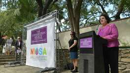 """Torrey Stanley Carleton, member of The Conservation Society of San Antonio board and marketing chair, announces the new logos for the society and for the popular Fiesta event called """"A Night in Old San Antonio"""" at La Villita on Tuesday, Sept. 17, 2019."""