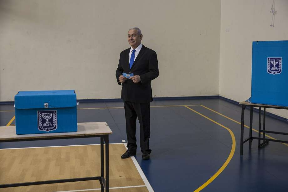 Longtime Israeli Prime Minister Benjamin prepares to vote at a polling station in Jerusalem. Photo: Heidi Levine / Associated Press