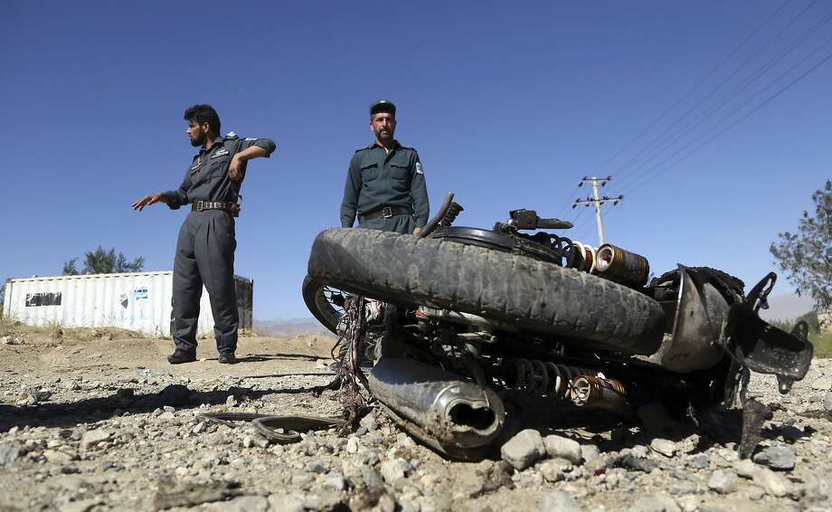 Afghan police inspect the site of a suicide attack, in northern Parwan province, Afghanistan, Tuesday, Sept. 17, 2019. The Taliban suicide bomber on a motorcycle targeted presidential guards who were protecting President Ashraf Ghani at a campaign rally in northern Afghanistan on Tuesday, killing over 20 people and wounding over 30. Ghani was present at the venue but was unharmed, according to his campaign chief. (AP Photo/Rahmat Gul) Photo: Rahmat Gul, Associated Press