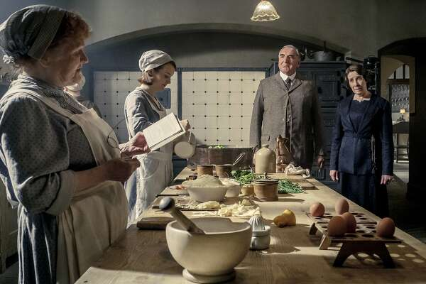 """This image released by Focus Features shows, from left, Lesley Nicol as Mrs. Patmore, Sophie McShera as Daisy, Jim Carter as Mr. Carson and Phyllis Logas as Mrs. Hughes in """"Downton Abbey"""". The film will be released Sept. 13, 2019, in the United Kingdom and on Sept. 20 in the United States. (Jaap Buitendijk/Focus Features via AP)"""