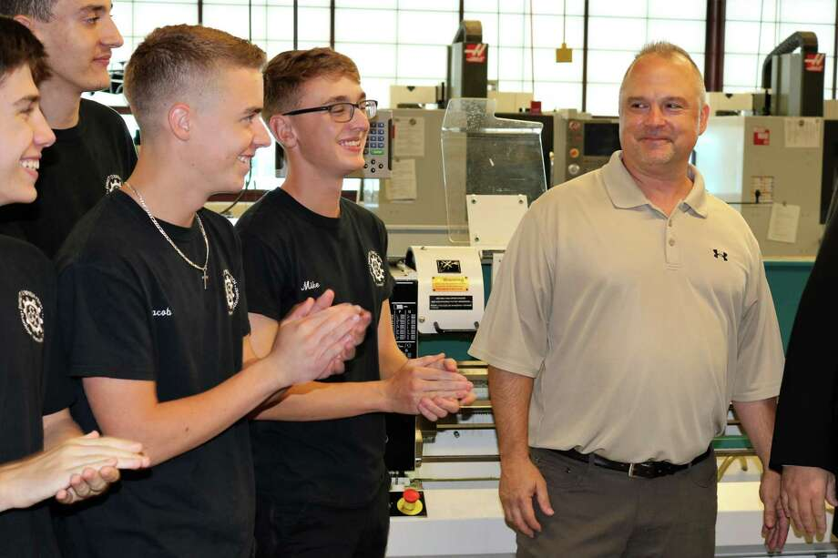 """Steven Orloski, a manufacturing instructor at Emmett O'Brien Technical High School, located in Ansonia,was named2019's Connecticut Technical Education and Career System (CTECS) Teacher of the Year, Superintendent of Schools Jeffery Wihbey announced. Orloski is a graduate of the CTECS system, having attended Bullard-Havens Technical High School's Machine Tool and Die program in the 1980's. His professional manufacturing career includes a Toolmaker Apprenticeship with Bremser Technologies, and experience at U.S. Baird Corp., Sikorsky Aircraft, and Inline Plastics Corp. He returned to teach for the technical high schools in 2004. """"I am completely honored and humbled to receive this amazing award,"""" said Orloski. """"It has been a remarkable experience for me to work in the same technical high school system that brought me so many rewarding and memorable experiences."""" Above, students applaud Orloski after hearing the announcement. Photo: Contributed Photo"""