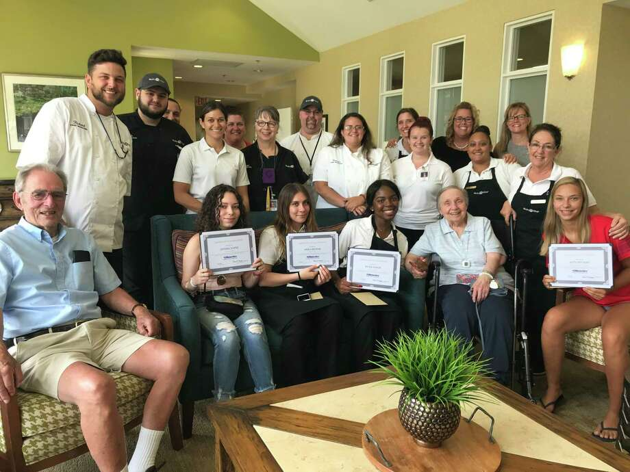 Wesley Village celebrated 12 student workers on July 2nd who graduated from local high schools. Residents and staff gathered together to honor the graduates at an afternoon party with cake and refreshments. Photo: Contributed Photo