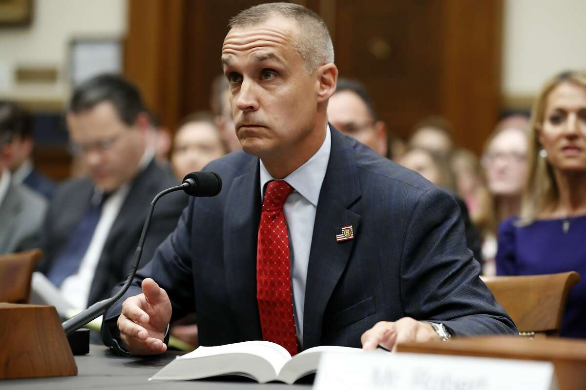 Corey Lewandowski, former campaign manager for President Donald Trump, references a copy of the Mueller Report that he requested, as he testifies to the House Judiciary Committee Tuesday, Sept. 17, 2019, in Washington. (AP Photo/Jacquelyn Martin)