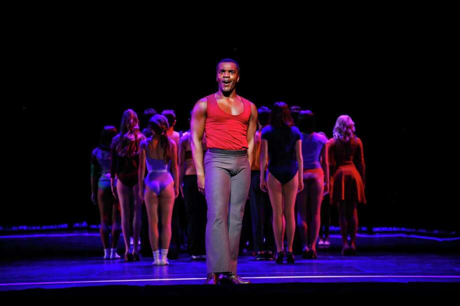 "Sharrod Williams as ""Richie"" and the Cast of the current TUTS production of A Chorus Line. Photo: Melissa Taylor"
