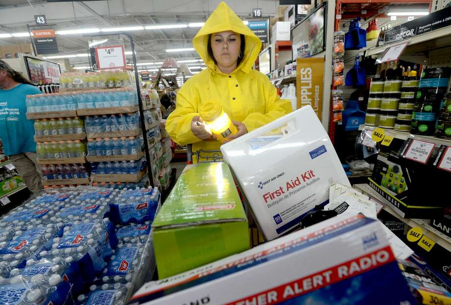 M & D Supply, Inc. - Ace Hardware social media coordinator Lainie Harris demonstrates what a successful shopping cart should include when preparing your home and family for a hurricane and possible damage clean-up once it passes.  Photo taken Wednesday, August 28, 2019 Kim Brent/The Enterprise Photo: Kim Brent/The Enterprise