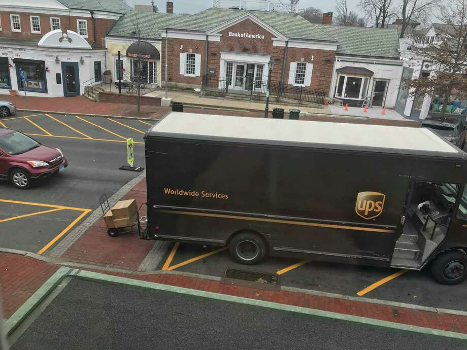 Box trucks are creating a hazard by blocking the crosswalks on Elm Street in New Canaan where parking spaces were relined to be consistent with a state law. Photo: Tucker Murphy / Contributed / New Canaan Advertiser / Connecticut Post