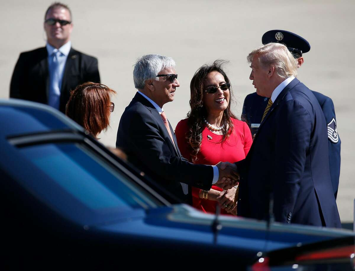 Harmeet Dhillon (center) and her husband Sarvjit Randhawa greet President Trump after arriving aboard Air Force One at Moffett Federal Airfield in Mountain View, Calif. to attend a Republican Party fundraiser at an undisclosed location on Tuesday, Sept. 17, 2019. At left is Robin Aube-Warren, acting assistant director of NASA Ames.