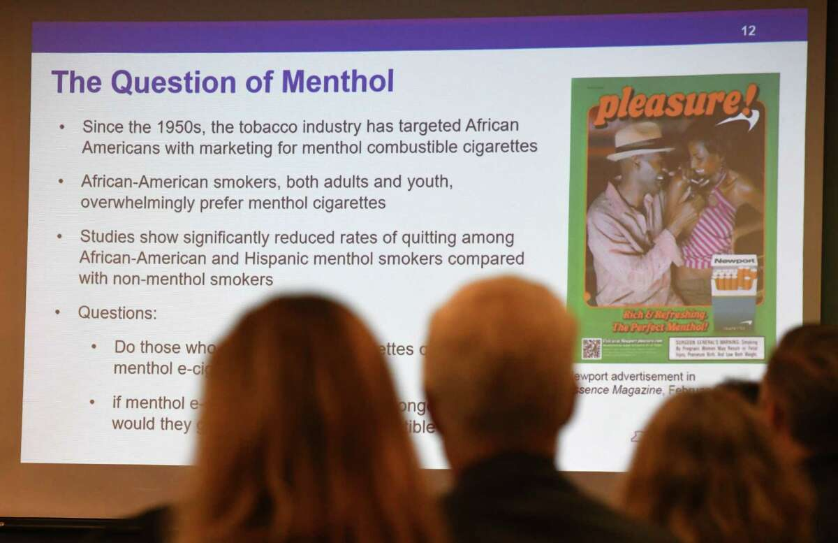 """Slide explains the history of menthol flavored tobacco products during a meeting of the state Public Health and Health Planning Council to vote on provisions to ban the sale of flavored e-cigarettes on Tuesday, Sept.17, 2019, at the Empire State Plaza Convention Center in Albany, N.Y. Gov. Andrew Cuomo announced Sunday """"an emergency action"""" to ban the sale of flavored electronic cigarettes statewide. (Will Waldron/Times Union)"""
