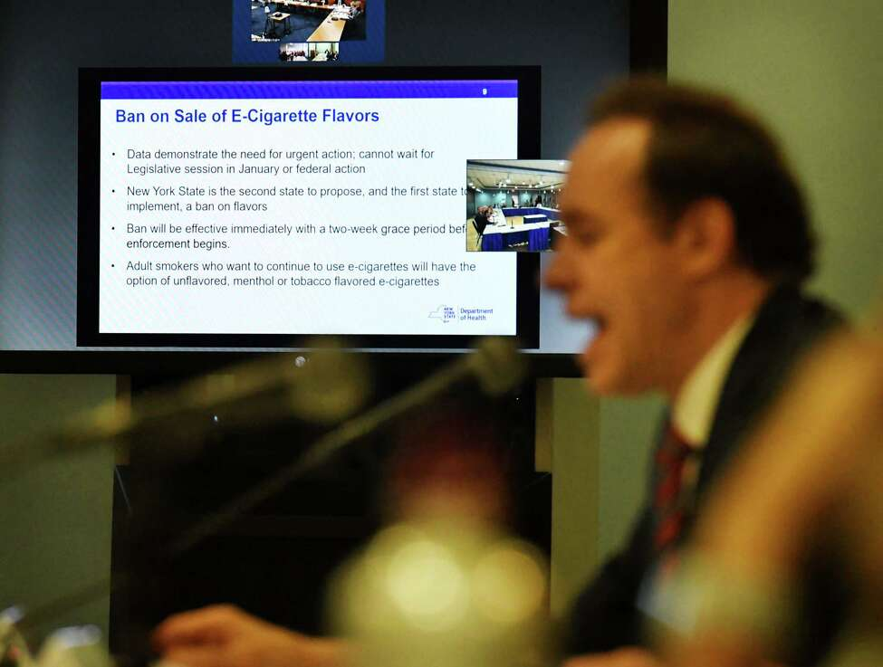 New York State Health Commissioner Howard Zucker speaks during a meeting of the state Public Health and Health Planning Council to vote on provisions to ban the sale of flavored e-cigarettes on Tuesday, Sept.17, 2019, at the Empire State Plaza Convention Center in Albany, N.Y. Gov. Andrew Cuomo announced Sunday