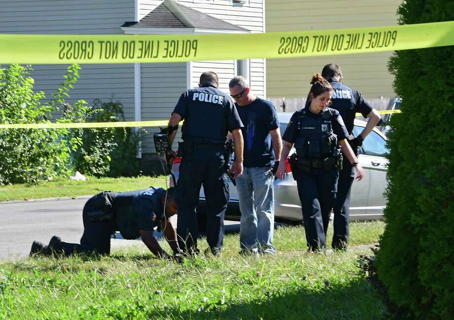 Police investigate at the scene of a homicide where a female was found dead from a head wound at 111th Street and Fourth Avenue on Tuesday, Sept. 17, 2019 in Troy, N.Y. (Lori Van Buren/Times Union) Photo: Lori Van Buren, Albany Times Union / 20047849A