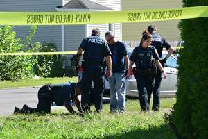 Police investigate at the scene of a homicide where a female was found dead from a head wound at 111th Street and Fourth Avenue on Tuesday, Sept. 17, 2019 in Troy, N.Y. (Lori Van Buren/Times Union)