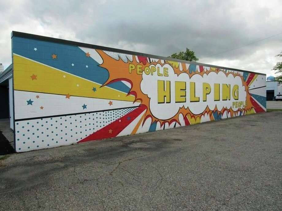 A mural covering the northwest side of the building located at 503 S. Saginaw Road was donated to Midland County Emergency Food Pantry Network by an anonymous donor. (Mitchell Kukulka/Mitchell.Kukulka@mdn.net)
