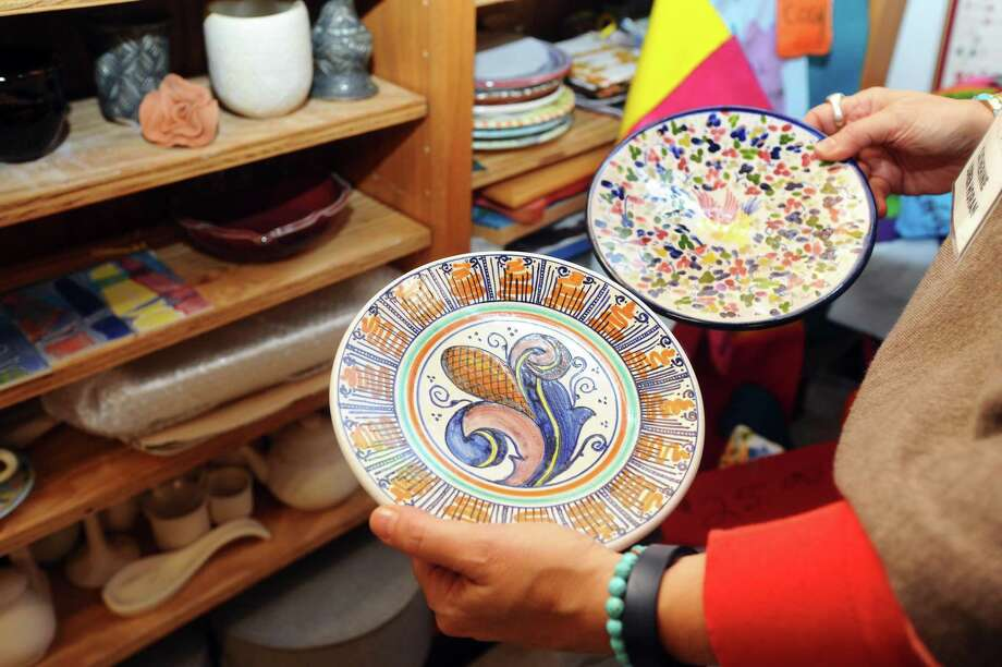 Catherine Horan shows off some of her painted pottery during the 2017 Loft Artists Association's Open Studios event. The 2019 edition take place November 1-3. Photo: Michael Cummo / Hearst Connecticut Media File Photo / Stamford Advocate