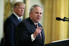 FILE - In this July 8, 2019, file photo President Donald Trump listens as then-Secretary of the Interior David Bernhardt speaks during an event on the environment in the East Room of the White House in Washington. In less than three years, Trump has named more former lobbyists to Cabinet-level posts than his most recent predecessors did in eight, putting a substantial amount of oversight in the hands of people with ties to the industries they're regulating. (AP Photo/Evan Vucci, File)