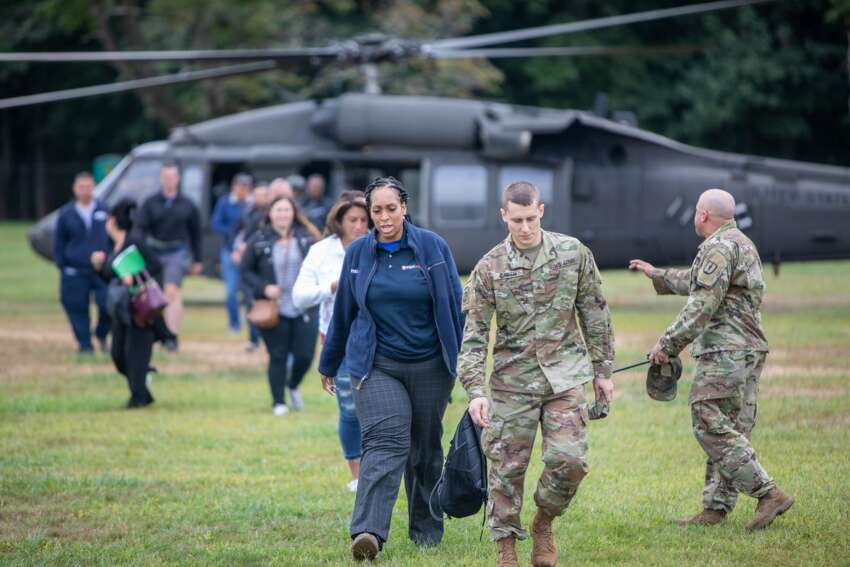 Civilians participating in a boss lift leave a UH-60 helicopter assigned to the New York Army National Guard at Camp Smith Training Site on Monday, Sept. 16, 2019.Twenty employers from the Albany, N.Y. area and Long Island visited Camp Smith Training Site to get a first hand look at New York Army National Guard training as part of the Employer Support of the Guard and Reserve program. ( NY Division of Military and Naval Affairs photo by NYG Specialist Michael T. Rehbaum)