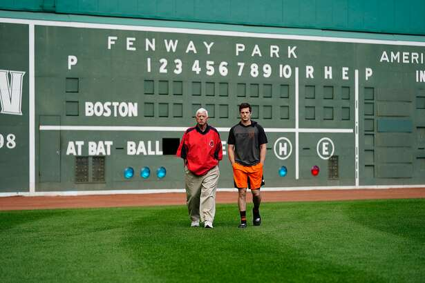 Hall of Famer Carl Yastrzemski walks with grandson Mike before the Giants rookie outfielder makes his major-league debut at Fenway Park on Tuesday, Sept. 17, 2019 in Boston.