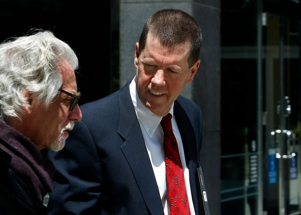 Sun Microsystems co-founder Scott McNealy leaves the Phillip Burton Federal Courthouse with an unidentified man (left) after testifying in Oracle lawsuit trial against Google in San Francisco, Calif. on Thursday, April 26, 2012.