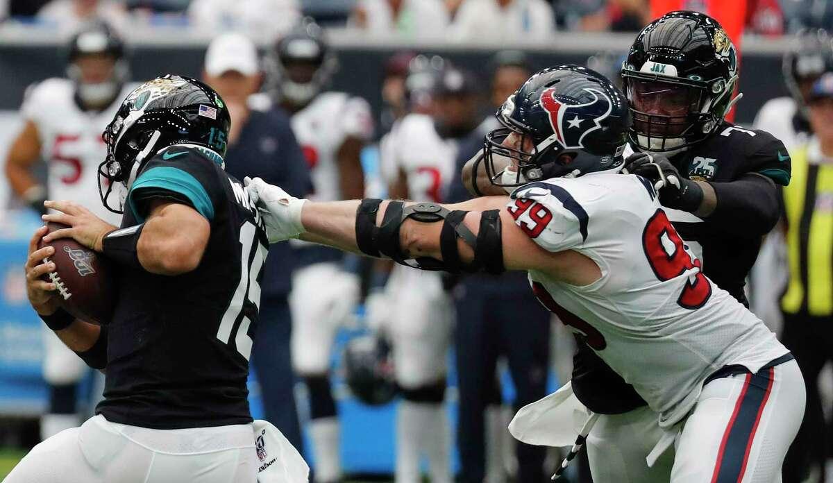 Jacksonville Jaguars quarterback Gardner Minshew (15) breaks out of the grasp of Houston Texans defensive end J.J. Watt (99) during an NFL football game at NRG Stadium on Sunday, Sept. 15, 2019, in Houston.