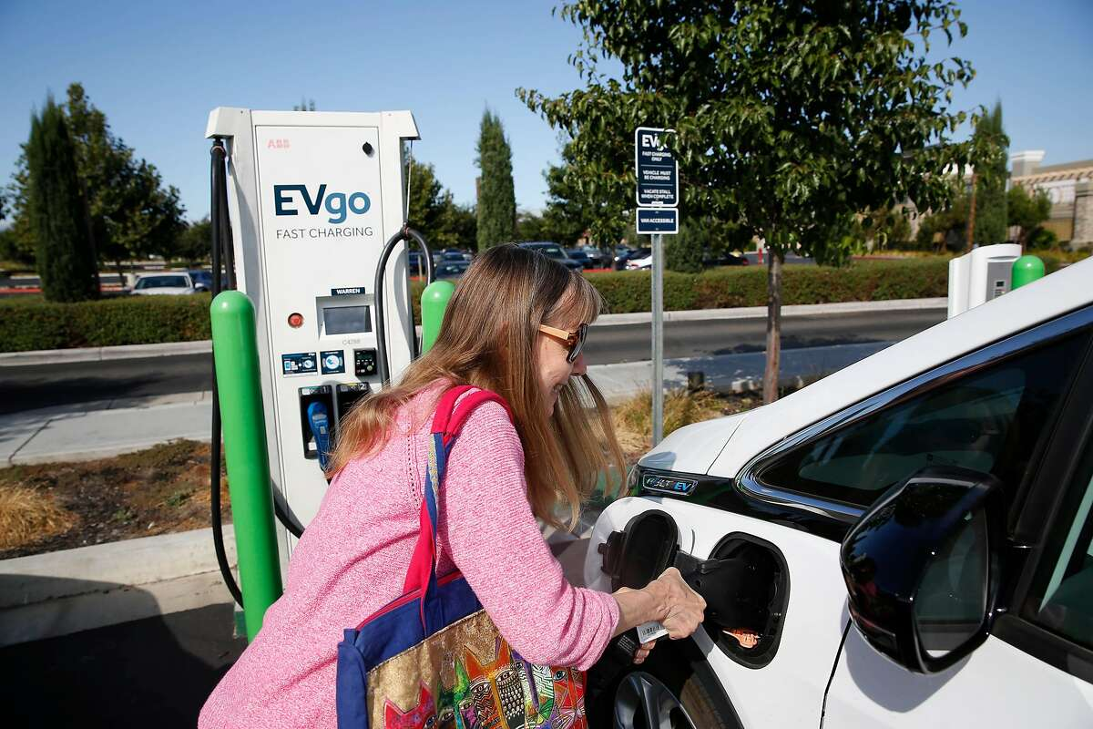 Terry Allen of Livermore charges her car at a Evgo station on Thursday, September 5, 2019 in Livermore, CA.
