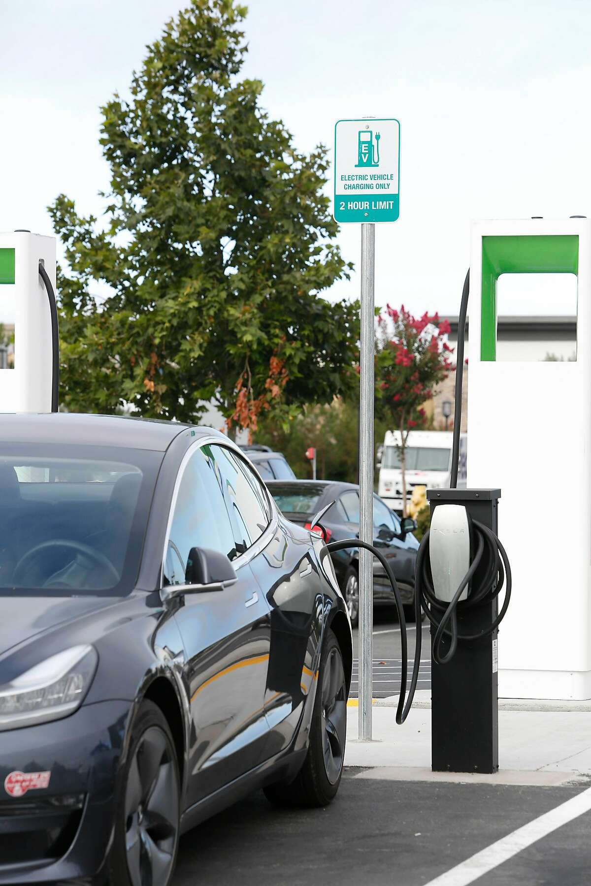 A car is seen attached to a Tesla EV charging port on Thursday, September 5, 2019 in Livermore, CA.