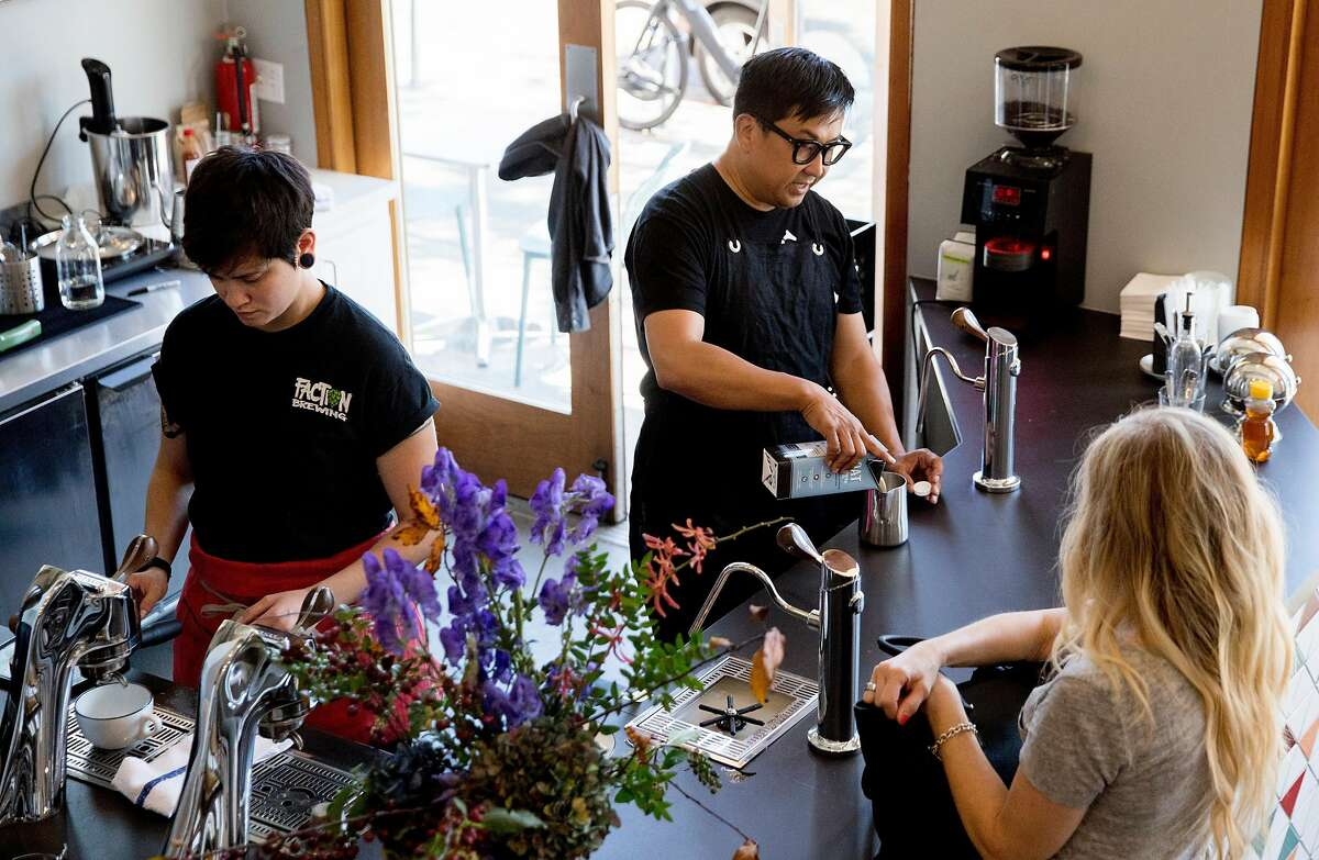 Wrecking Ball Coffee founder and owner Nick Cho (center) works behind the counter to create drinks at his shop along Shattuck Avenue in Berkeley, Calif. Tuesday, September 17, 2019.