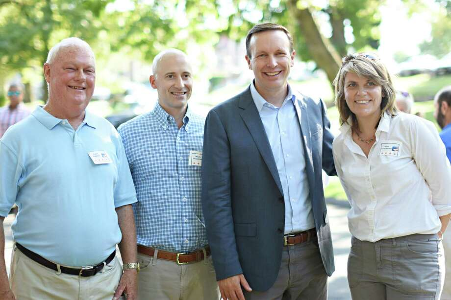 Democratic Town Council candidates greet U.S. Sen. Chris Murphy at Sunday's 16th annual DTC BBQ at the Carriage Barn Arts Center. From left are Colm Dobbyn, Mark Grzymski, Murphy, and Robin Bates-Mason. Photo: Contributed Photo / New Canaan Democrats / New Canaan Advertiser Contributed
