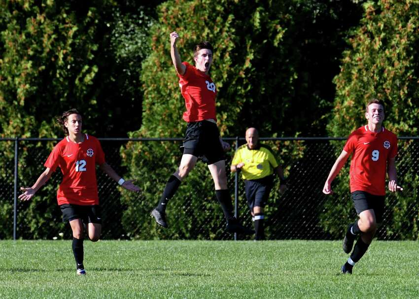 Niskayuna midfielder Toby Goldner, center, celebrates with teammates Nick Viggiani, left, and Jordan Angrist, right, after scoring in the first half against CBA on Tuesday, Sept.17, 2019, at Niskayuna High School in Niskayuna, N.Y. (Will Waldron/Times Union)