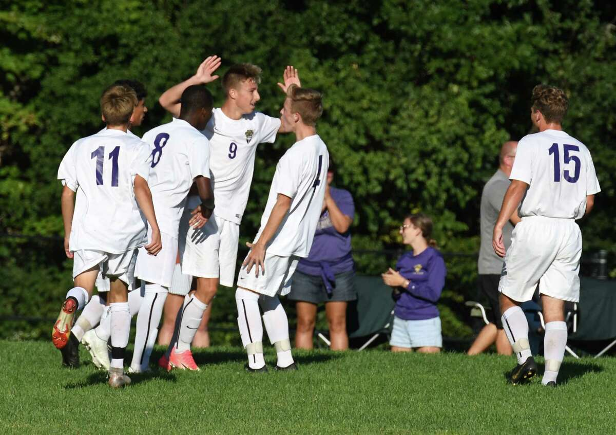 Christian Brothers Academy forward Jack Mendrysa, center #9, celebrates with teammates after scoring in the second half against Niskayuna on Tuesday, Sept.17, 2019, at Niskayuna High School in Niskayuna, N.Y. (Will Waldron/Times Union)