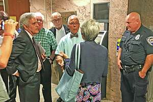 Middletown common councilors confront attorney Margaret P. Mason, author of the report by an independent investigator into the alleged gender discrimination grievance filed by a Board of Education employee, at Town Hall last August.