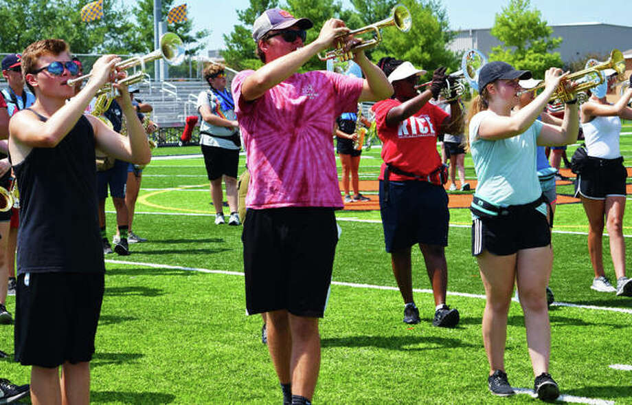 Members of the EHS Marching Band practice at the EHS Sports Complex. Edwardsville High School will host the 12 annual Tiger Ambush Classic Sept. 21. Photo: Photos By Tyler Pletsch | The Intelligencer